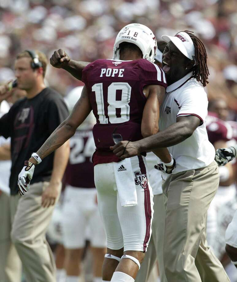 Texas A&M Aggies wide receiver Edward Pope (18) gets a hug from a coach on the sideline after his touchdown in the end zone during the first half of a college football game at Kyle Stadium, Saturday, Sept. 14, 2013, in College Station. Photo: Karen Warren, Houston Chronicle / © 2013 Houston Chronicle