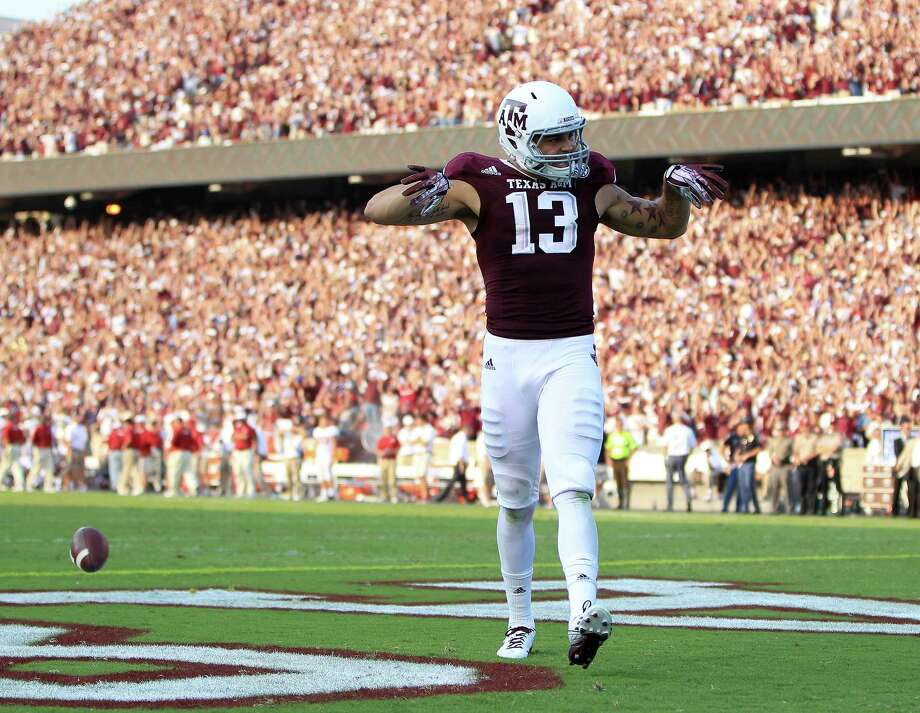 Texas A&M Aggies wide receiver Mike Evans (13) celebrates his touchdown on a Johnny Manziel 95-yard touchdown pass during the fourth quarter of a college football game at Kyle Stadium, Saturday, Sept. 14, 2013, in College Station. Photo: Karen Warren, Houston Chronicle / © 2013 Houston Chronicle