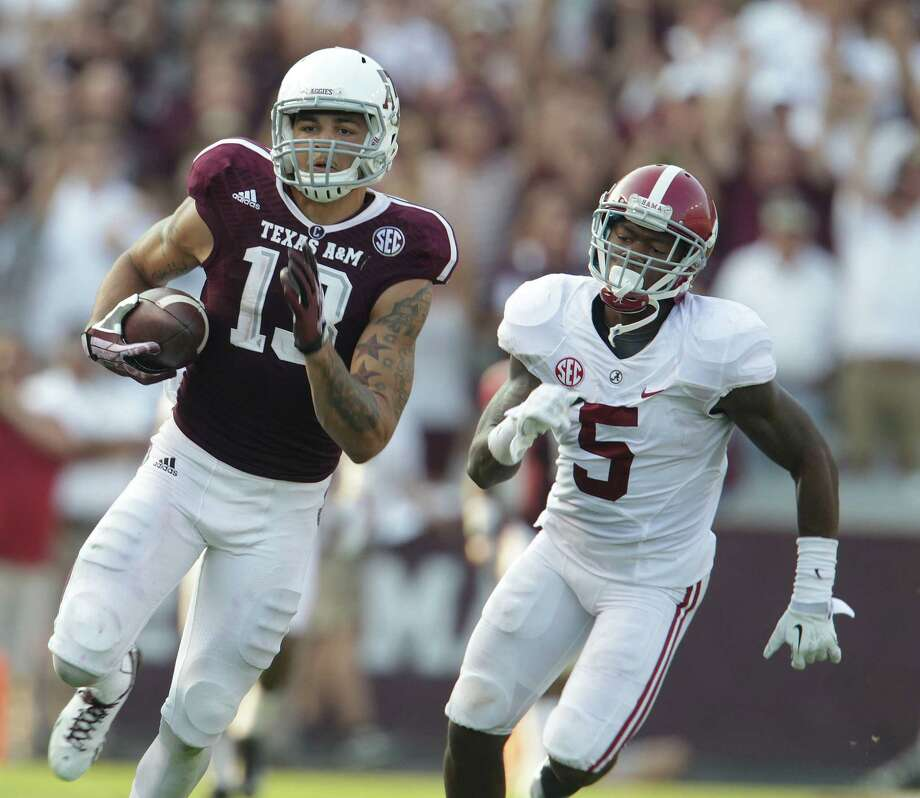 Texas A&M Aggies wide receiver Mike Evans (13) runs a 95-yard touchdown pass from Texas A&M Aggies quarterback Johnny Manziel (2) during the fourth quarter of a college football game at Kyle Stadium, Saturday, Sept. 14, 2013, in College Station. Photo: Karen Warren, Houston Chronicle / © 2013 Houston Chronicle