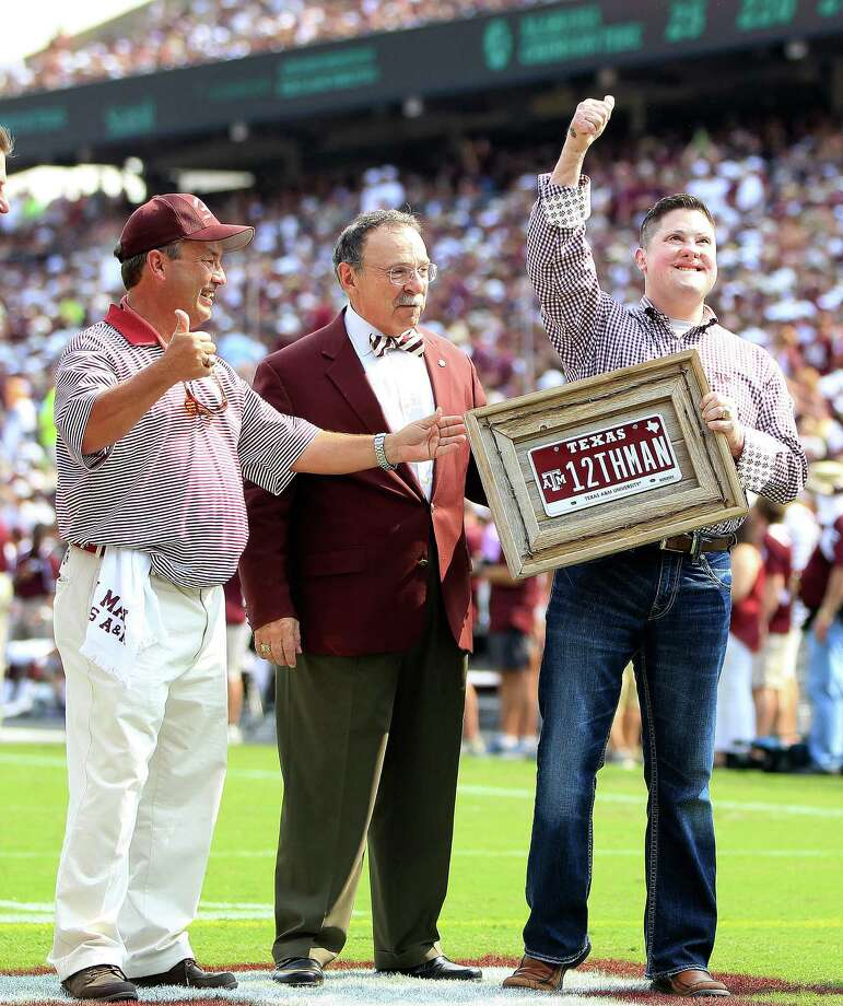 Marine Captain Daniel Moran, Aggie class of 2003 receives the 12th man special Aggie license plate bought by Houston lawyer Tony Buzbee, during a time out in the second quarter of a college football game at Kyle Stadium, Saturday, Sept. 14, 2013, in College Station. Photo: Karen Warren, Houston Chronicle / © 2013 Houston Chronicle