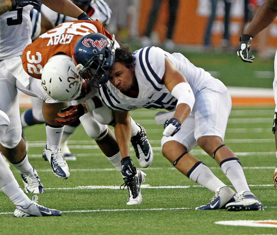 Mississippi defensive back Cody Prewitt loses his helmet while trying to tackle Texas running back Johnathan Grey. Photo: Michael Thomas, FRE / FR65778 AP