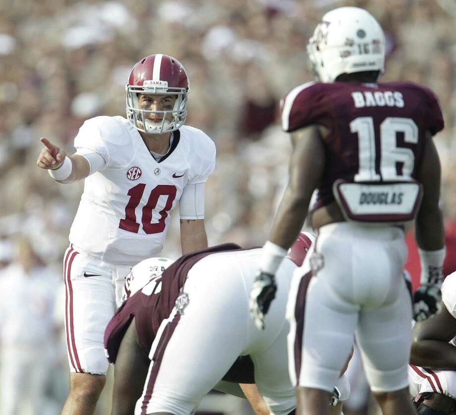 AJ McCarron earned praise from his coach and teammates for his leadership, both when the Tide fell behind early and when Texas A&M made a late run. Photo: Karen Warren / Houston Chronicle