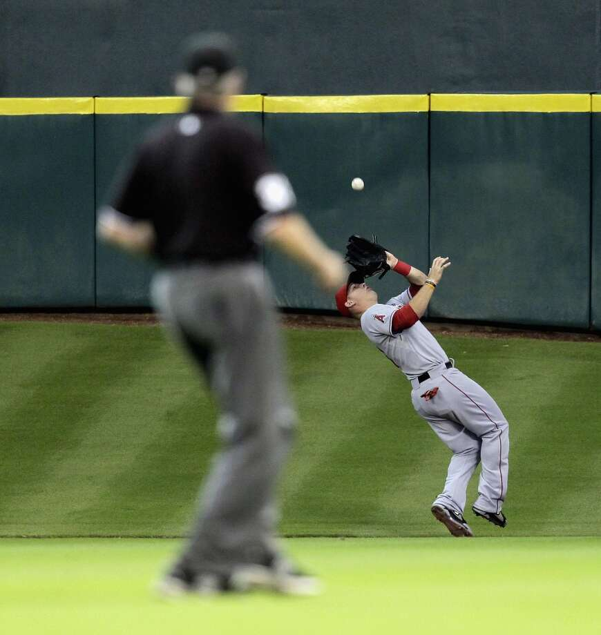 Mike Trout #27 of the Angels makes a catch in center field. Photo: Bob Levey, Getty Images