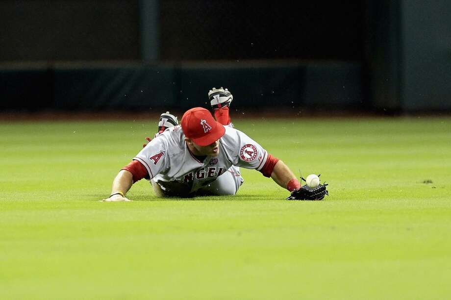 Mike Trout #27 of the Angels dives but can't make the catch on a shallow fly ball hit by Matt Dominguez. Photo: Bob Levey, Getty Images