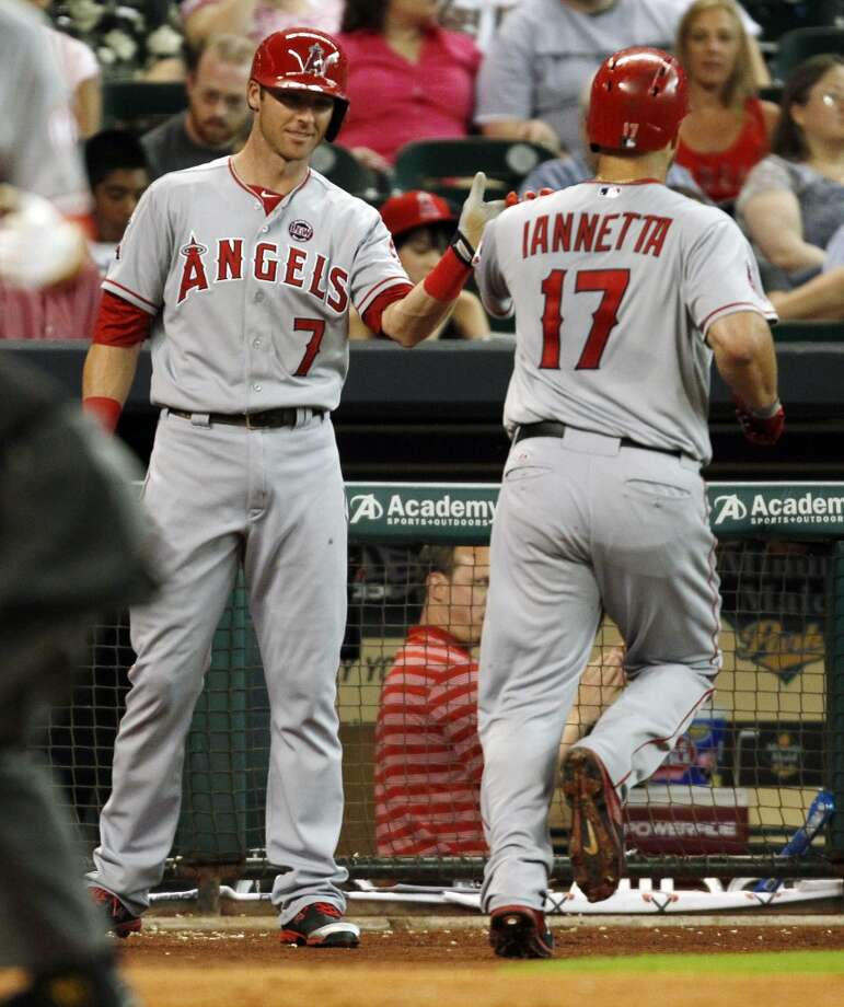 Chris Iannetta, right, celebrates his solo home run with Andrew Romine. Photo: Eric Christian Smith, Associated Press