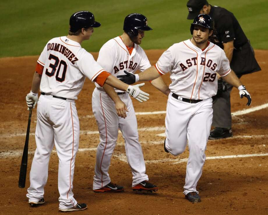 Brett Wallace, (29) is congratulated by teammates Matt Dominguez, (30) and Trevor Crowe after hitting a two-run home run. Photo: Eric Christian Smith, Associated Press