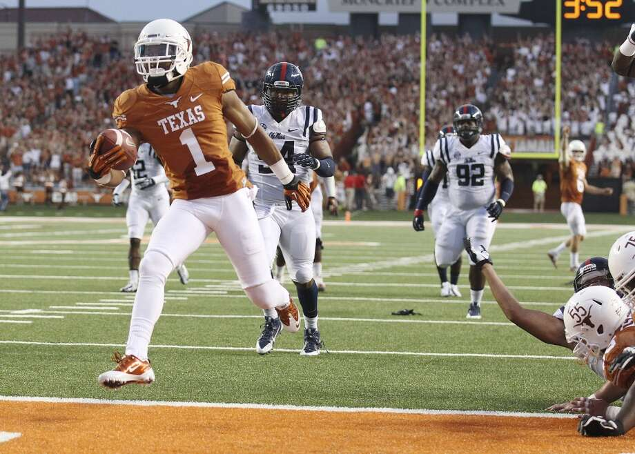 Texas receiver Mike Davis (01) runs in for a touchdown against Ole Miss in the first half in Austin on Saturday, Sept. 14, 2013. (Kin Man Hui/San Antonio Express-News) Photo: San Antonio Express-News