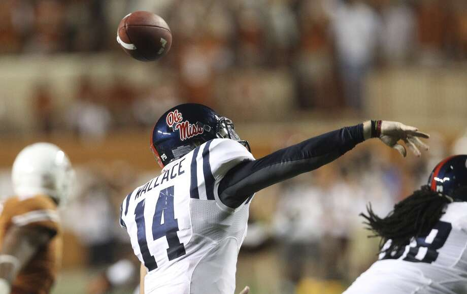 Ole Miss quarterback Bo Wallace (14) mishandles a pass that results in a turnover against Texas in the first half in Austin on Saturday, Sept. 14, 2013. (Kin Man Hui/San Antonio Express-News) Photo: San Antonio Express-News