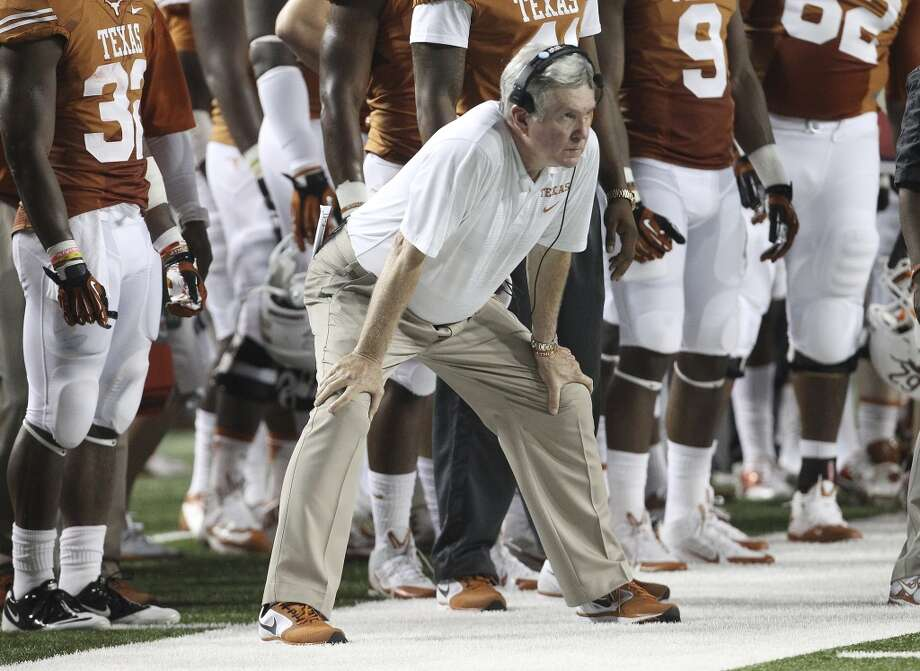Texas coach Mac Brown watches his team from the sideline against Ole Miss in the first half in Austin on Saturday, Sept. 14, 2013. (Kin Man Hui/San Antonio Express-News) Photo: San Antonio Express-News