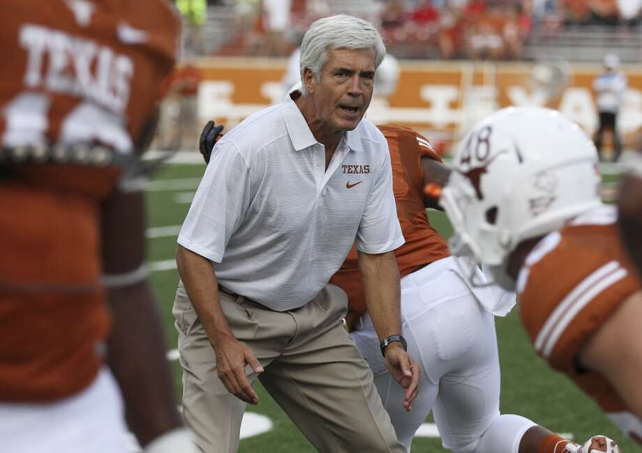 Texas defensive coordinator Greg Robinson goes over drills with his players before the game against Ole Miss in the first half in Austin on Saturday, Sept. 14, 2013. (Kin Man Hui/San Antonio Express-News) Photo: San Antonio Express-News