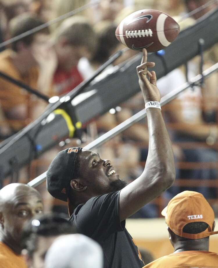 Former Texas basketball standout and current Oklahoma City Thunder forward Kevin Durant watches the Texas - Ole Miss game in the first half in Austin on Saturday, Sept. 14, 2013. (Kin Man Hui/San Antonio Express-News) Photo: San Antonio Express-News