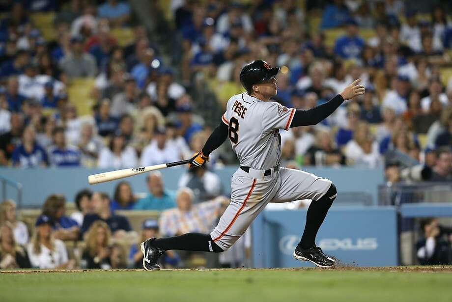 Hunter Pence hits a grand slam as part of the Giants' Dodger Stadium record for most runs. Photo: Stephen Dunn, Getty Images