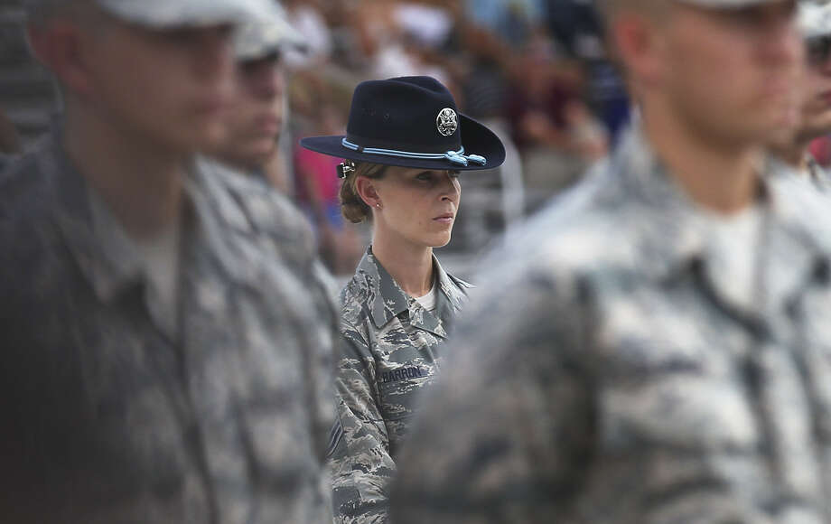 These days, about 20 percent of all instructors at Joint Base San Antonio-Lackland are women. That is up from about 11 percent last year. Photo: Kin Man Hui / San Antonio Express-News