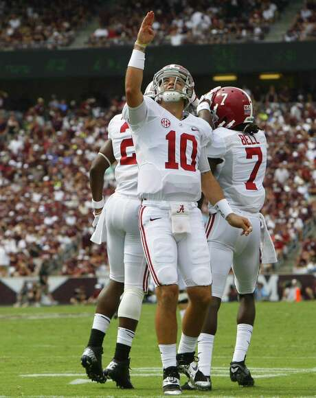 Alabama quarterback AJ McCarron celebrates his 51-yard touchdown pass to Kenny Bell in the second quarter that gave the Crimson Tide the lead for good. McCarron was 20-of-29 passing for 338 yards and four TDs. Photo: Cody Duty / Houston Chronicle