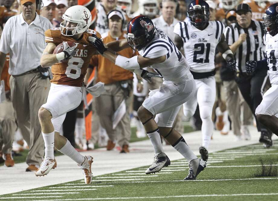 Texas' Jaxon Shipley (08) gets pushed out of bounds by Ole Miss' Cody Prewitt (25) in the first half in Austin on Saturday, Sept. 14, 2013. (Kin Man Hui/San Antonio Express-News) Photo: Kin Man Hui, San Antonio Express-News