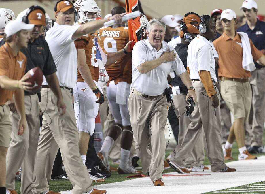 Texas coach Mac Brown reacts on the sideline against Ole Miss in the first half in Austin on Saturday, Sept. 14, 2013. (Kin Man Hui/San Antonio Express-News) Photo: Kin Man Hui, San Antonio Express-News