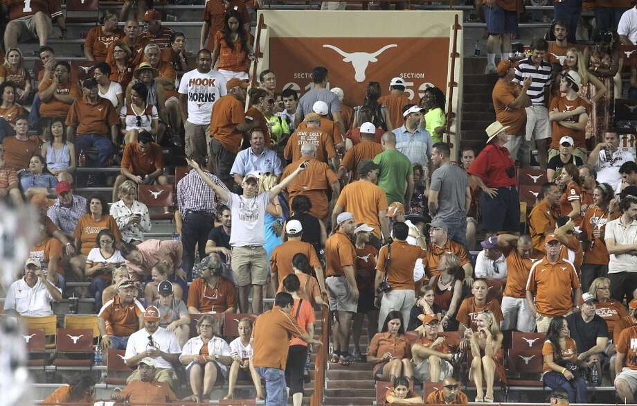 Texas fans head to the exits during the Longhorns' game against Ole Miss in the second half in Austin on Saturday, Sept. 14, 2013. Ole Miss defeats Texas, 44-23. (Kin Man Hui/San Antonio Express-News) Photo: Kin Man Hui, San Antonio Express-News