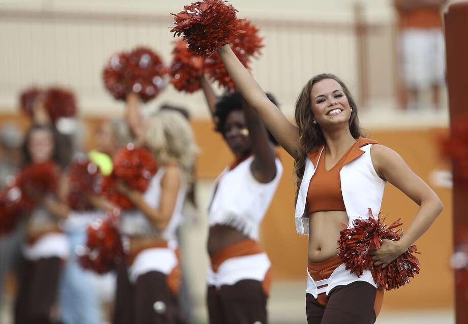 Texas Longhorn pom squad cheer on the team against Ole Miss in the first half in Austin on Saturday, Sept. 14, 2013. (Kin Man Hui/San Antonio Express-News) Photo: Kin Man Hui, San Antonio Express-News