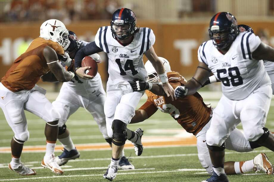 Ole Miss quarterback Bo Wallace (14) runs with the ball against Texas in the second half in Austin on Saturday, Sept. 14, 2013. Ole Miss defeats Texas, 44-23. (Kin Man Hui/San Antonio Express-News) Photo: Kin Man Hui, San Antonio Express-News
