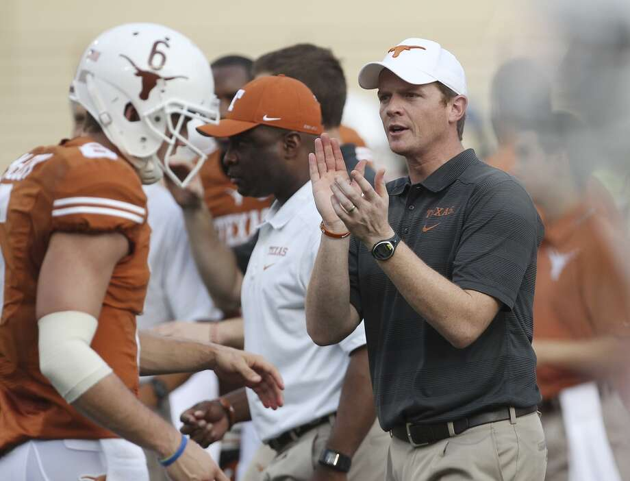 Texas offense coordinator Major Applewhite leads players in drills before the game against Ole Miss in Austin on Saturday, Sept. 14, 2013. (Kin Man Hui/San Antonio Express-News) Photo: Kin Man Hui, San Antonio Express-News
