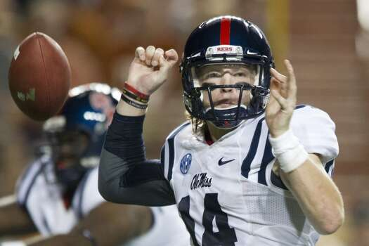 Bo Wallace #14 of the Mississippi Rebels loses control of the ball. Photo: Cooper Neill, Getty Images