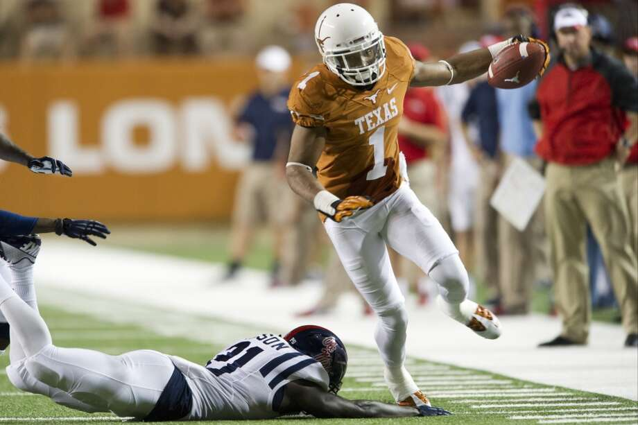 Mike Davis #1 of the Texas Longhorns breaks free after a catch. Photo: Cooper Neill, Getty Images