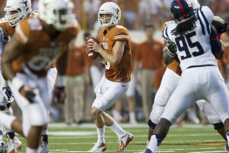 Case McCoy #6 of the Texas Longhorns drops back to throw a pass. Photo: Cooper Neill, Getty Images