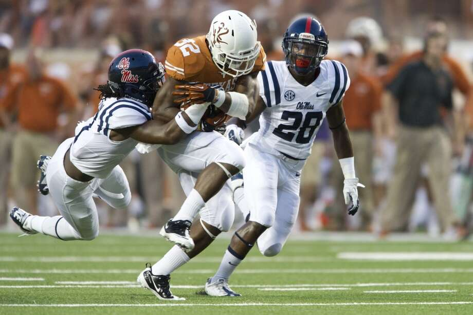 Johnathan Gray #32 of the Texas Longhorns tries to break free. Photo: Cooper Neill, Getty Images