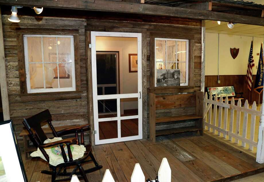 This Aug. 22, 2013, photo shows a replica of sorts fashioned from wood from Woody Guthrie's childhood home at the Okfuskee County History Center in Okemah, Okla. Developers working with the blessing of Guthrie�s relatives have announced plans to rebuild his 1860s-era boyhood home in Okemah, a town of 3,300 people about an hour�s drive south of Tulsa. Guthrie�s dilapidated boyhood home was ordered torn down in the late 1970s. Photo: AP