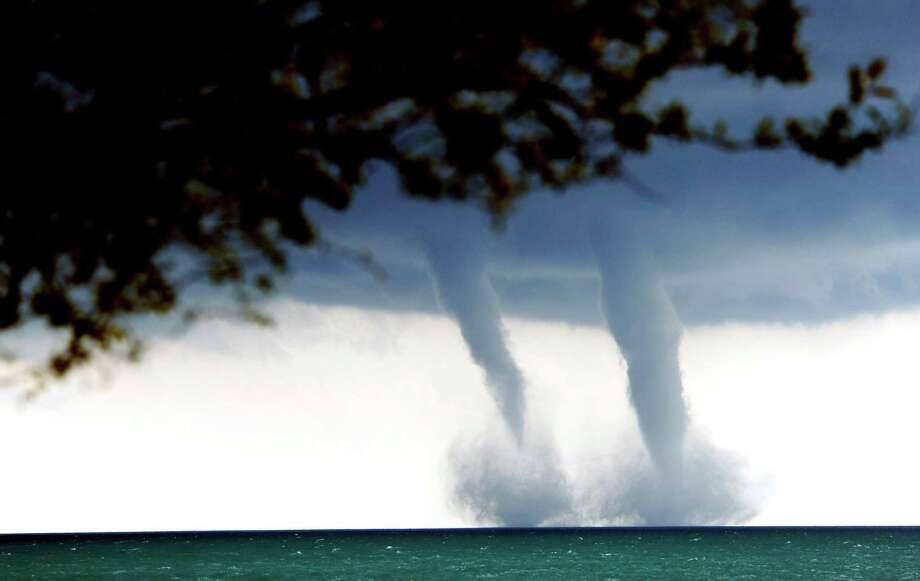 A pair of water spouts form on Lake Michigan southeast of Kenosha, Wis. on Thursday, Sept. 12, 2013. The National Weather Service in Sullivan said the water spouts occurred about four miles southeast from Kenosha. A water spout is basically a tornado over water, meteorologist Ed Townsend said. Photo: AP