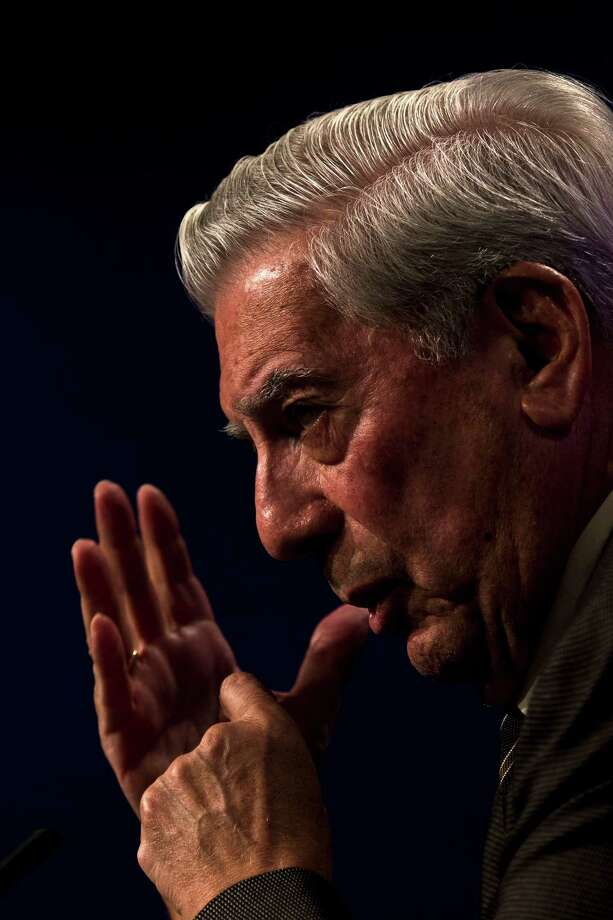 Peruvian writer and Nobel Prize winner in literature Mario Vargas Llosa speaks during the presentation of his latest book 'El Heroe discreto' or 'The Discreet Hero' at the Casa de America in Madrid, Spain, Wednesday, Sep. 11, 2013. Photo: AP