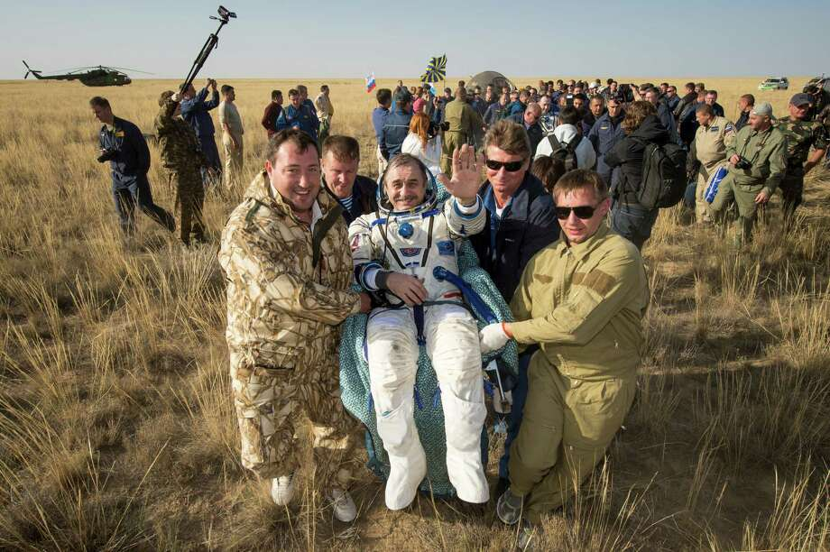Expedition 36 Commander Pavel Vinogradov of the Russian Federal Space Agency (Roscosmos) is carried to the medical tent shortly after he and, Flight Engineer Alexander Misurkin of Roscosmos and Flight Engineer Chris Cassidy of NASA landed in their Soyuz capsule in a remote area near the town of Zhezkazgan, Kazakhstan, on Wednesday, Sept. 11, 2013. Vinogradov, Misurkin and Cassidy returned to Earth after 166 days on the International Space Station. Photo: AP