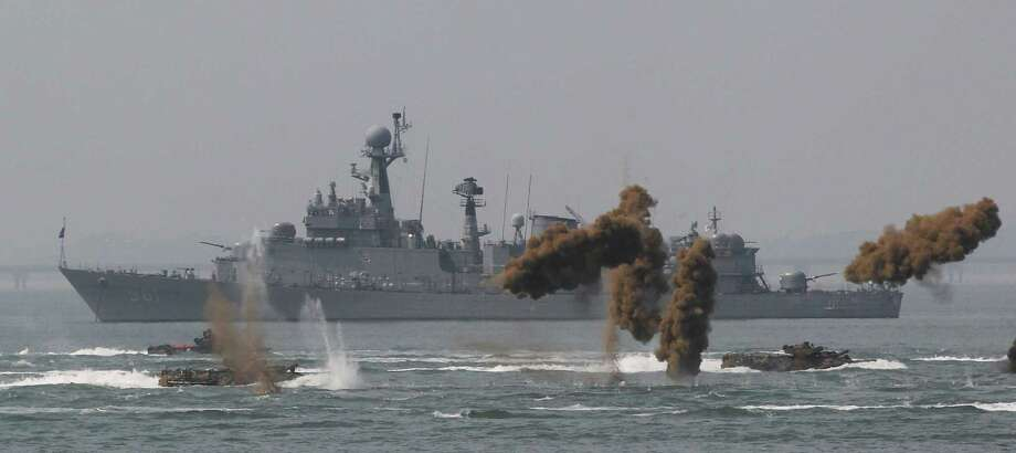 South Korean marine landing craft make their way to the shore through smoke screens during the 63rd Incheon Landing Operations Commemoration ceremony on Sunday, Sept. 15, 2013, in waters off Incheon, South Korea. Incheon is the coastal city where United Nations Forces led by U.S. General Douglas MacArthur landed in September 1950 just months after North Korea invaded the South. Photo: AP
