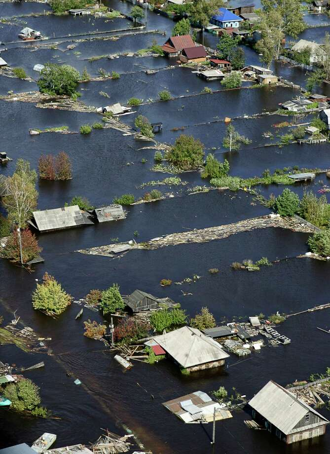 A photo taken from a helicopter shows flooded houses on the outskirts of the Komsomolsk-on-Amur the Russian Far Eastern Amur region, Thursday, Sept. 12, 2013.  Flooding in Russia's Far East, the worst since records began over a century ago, continued to affect residents across the region. Photo: AP
