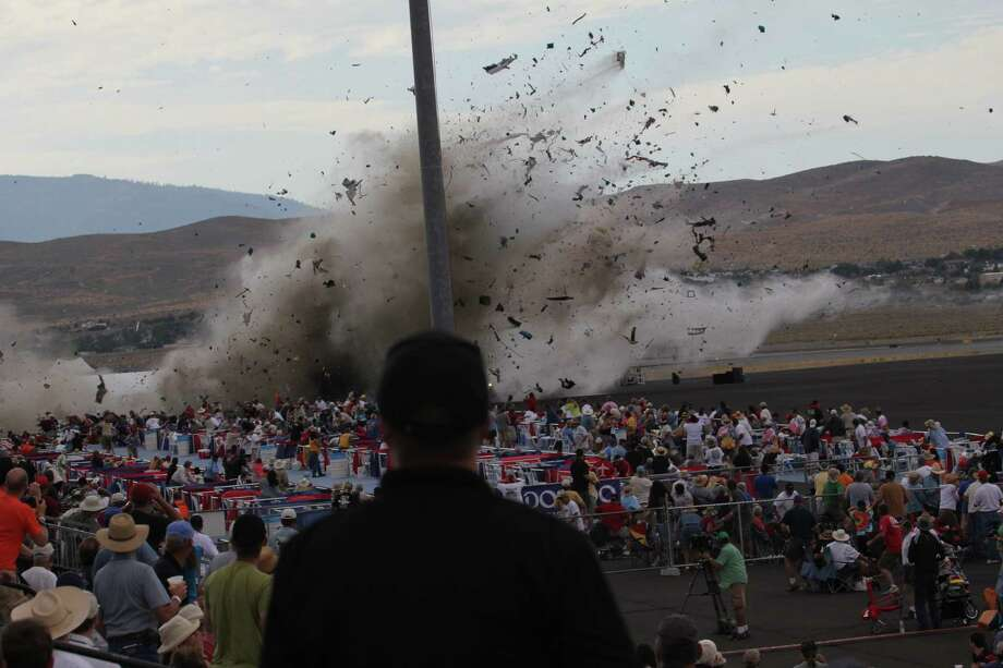 File - This Sept. 16, 2011 file photo shows a P-51 Mustang airplane crashing into the edge of the grandstands at Reno-Stead Airport during the Reno Air show in Stead, Nev. The World War II-era fighter plane flown by a veteran Hollywood stunt pilot Jimmy Leeward plunged into the apron of the grandstand, killing Leeward and 10 people on the ground and seriously injuring scores more. Race organizers are embracing the 50th anniversary of the National Air Racing Championships as they try to put the tragedy behind. Photo: AP