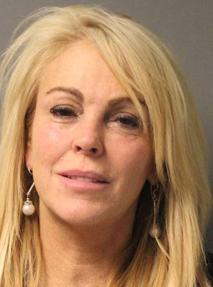 This photo provided by the New York State Police in East Farmingdale, N.Y., shows Dina Lohan after she was arrested late Thursday, Sept. 12, 2013 on aggravated drunken driving charges.  Police said Lohan, 50, the mother of Lindsay Lohan, was driving above the speed limit on the Northern State Parkway at approximately 11:00 pm and a breath test showed her blood-alcohol level to be more than twice New York's legal limit. Photo: AP