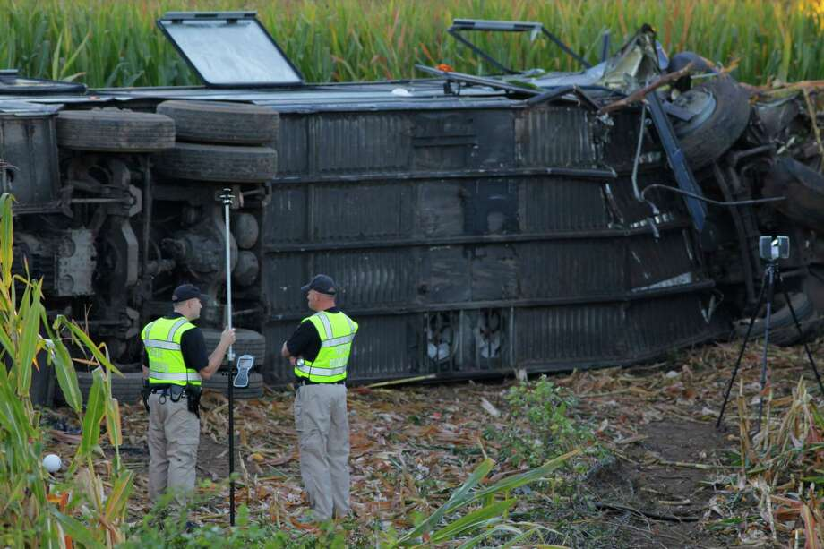 Ohio High Highway Patrol investigators on the scene of a Greyhound bus travailing from Cincinnati to Detroit  Saturday Sept. 14, 2013, with 52 passengers on board left the highway and  crashed in Liberty Township, between State Rt. 129 and the Monroe Exit at St. Rt.63, 34 passengers where taken to area hospitals, according to the Butler County Sheriff�s Office only 2 of 3 northbound of Interstate 75 are open. Photo: AP