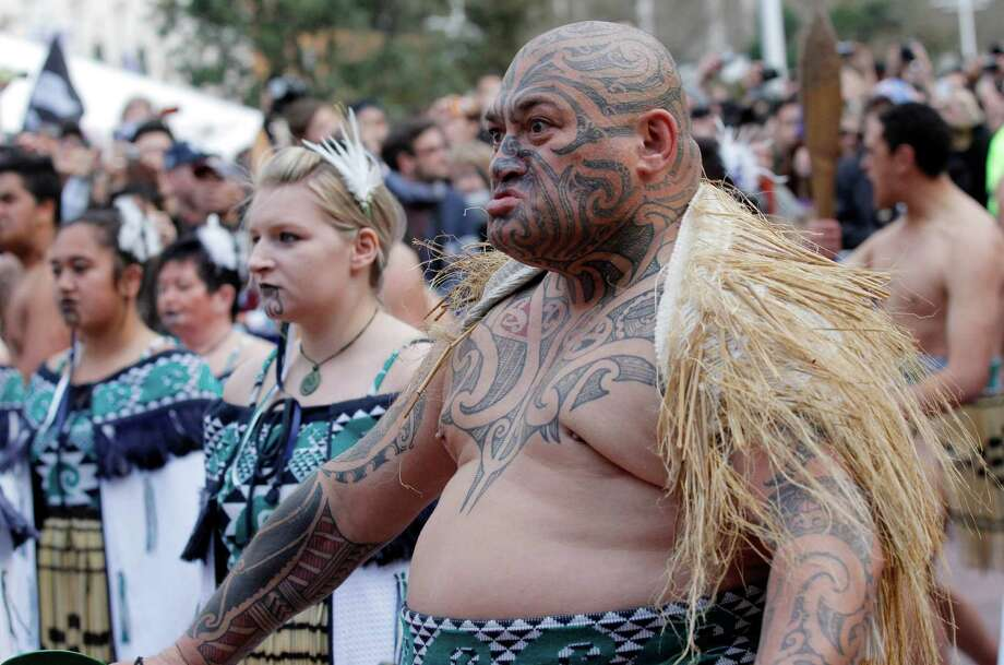 FILE - In this Sept. 3, 2011 file photo, a New Zealand Maori warrior performs a haka to the New Zealand All Blacks rugby team during their official Rugby World Cup welcoming ceremony in Auckland, New Zealand. With the Olympics headed to Tokyo, Japanese government officials are raising concern after a New Zealand woman with a traditional Maori tattoo was recently denied entry to a bathhouse. Public baths commonly ban tattoos because they are considered an anti-social statement or a sign of possible involvement with organized crime. Japanese media reported that Maori language lecturer Erana Brewerton was in Japan for an academic conference, and was turned away when she tried to go to a hot spring in Hokkaido on Sunday, Sept. 8, 2013. Photo: AP