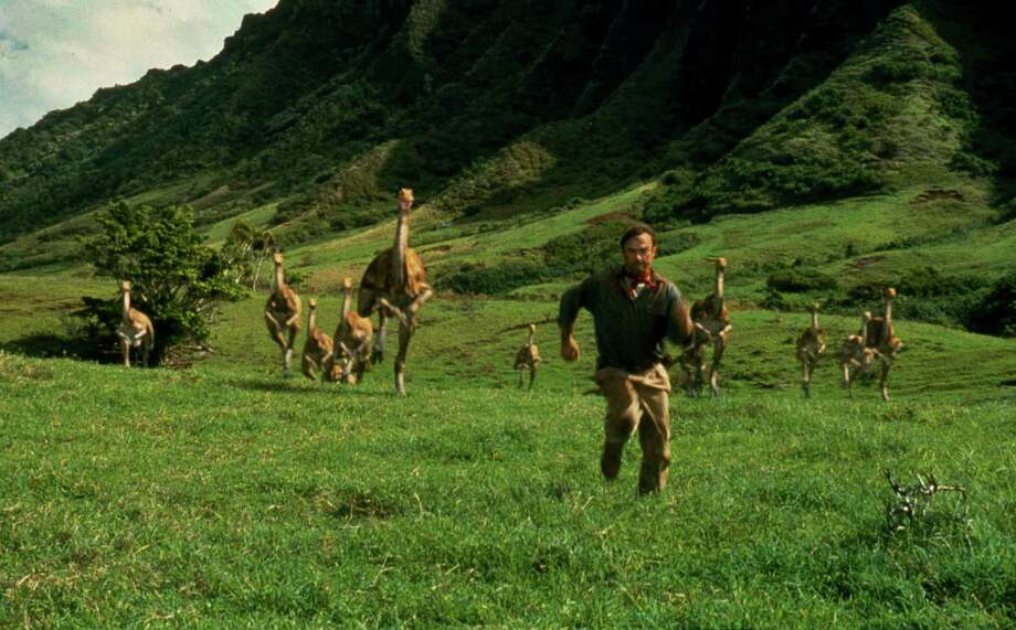 "FILE - In this 1993 file image originally released by Universal Pictures, Sam Neill, portraying Dr. Alan Grant, runs from dinosaurs in a scene from ""Jurassic Park."" The fourth installment of ""Jurassic Park"" has a name: ""Jurassic World."" Universal Pictures announced on Tuesday, Sept. 10, 2013, the film's new title and release date for the sequel to hatch in 3D on June 12, 2015. Photo: AP"