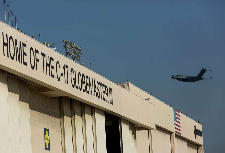 A U.S. Air Force C-17 Globemaster III cargo jet flies away, as Boeing Co. delivers the last for the U.S. Air Force to members of the U.S. Air Force at the aerospace company's plant in Long Beach, Calif., Thursday, Sept. 12, 2013. The Long Beach assembly line still has pending orders in the foreign market. Boeing's overseas customers include the United Kingdom, Australia, India and NATO. (AP Photo/Damian Dovarganes)3 Photo: AP