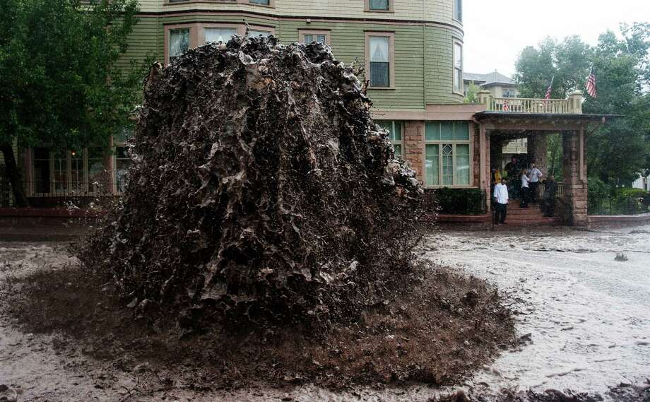 Flood water shoots out of a sewer on Canon Avenue next to the Cliff House in Manitou Springs, Colo. Thursday, Sept. 12, 2013 as storms continue to dump rain over the Waldo Canyon burn scar. Photo: AP