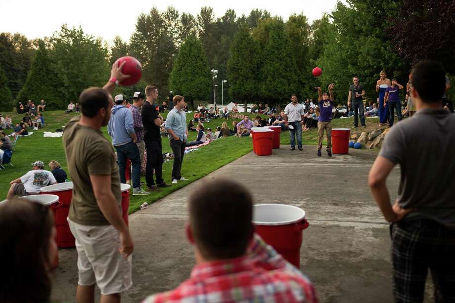 Attendees play garbage can-sized beer pong on a hill overlooking the Redhook Brewery's annual outdoor SausageFest concert Saturday, September 14, 2013, at Redhook Brewery in Woodinville. Photo: JORDAN STEAD, SEATTLEPI.COM / SEATTLEPI.COM