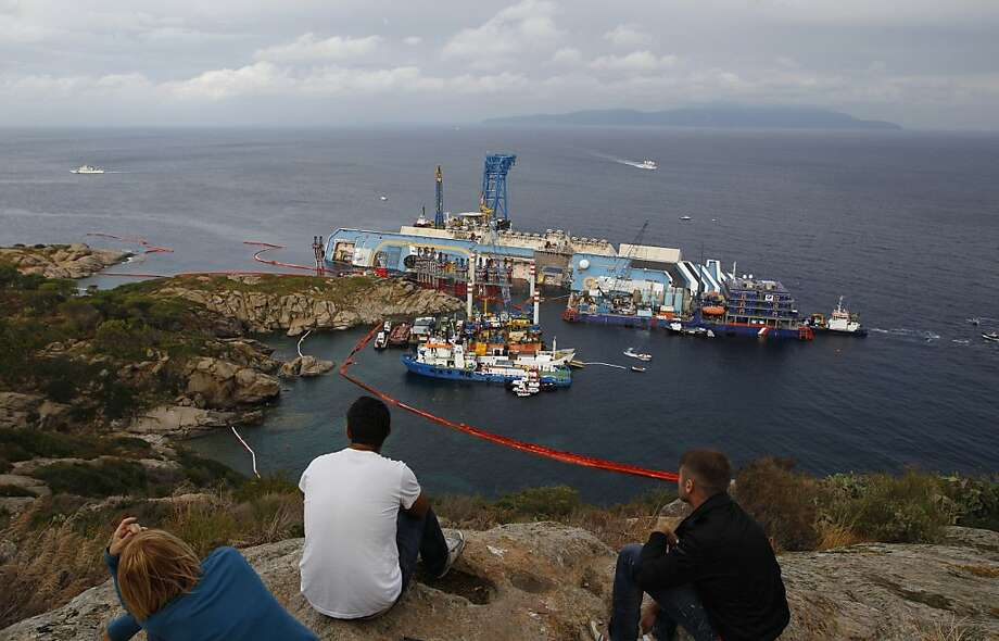 The Costa Concordia lies on its side off the Tuscan island of Giglio. The captain is now on trial. Photo: Andrew Medichini, Associated Press
