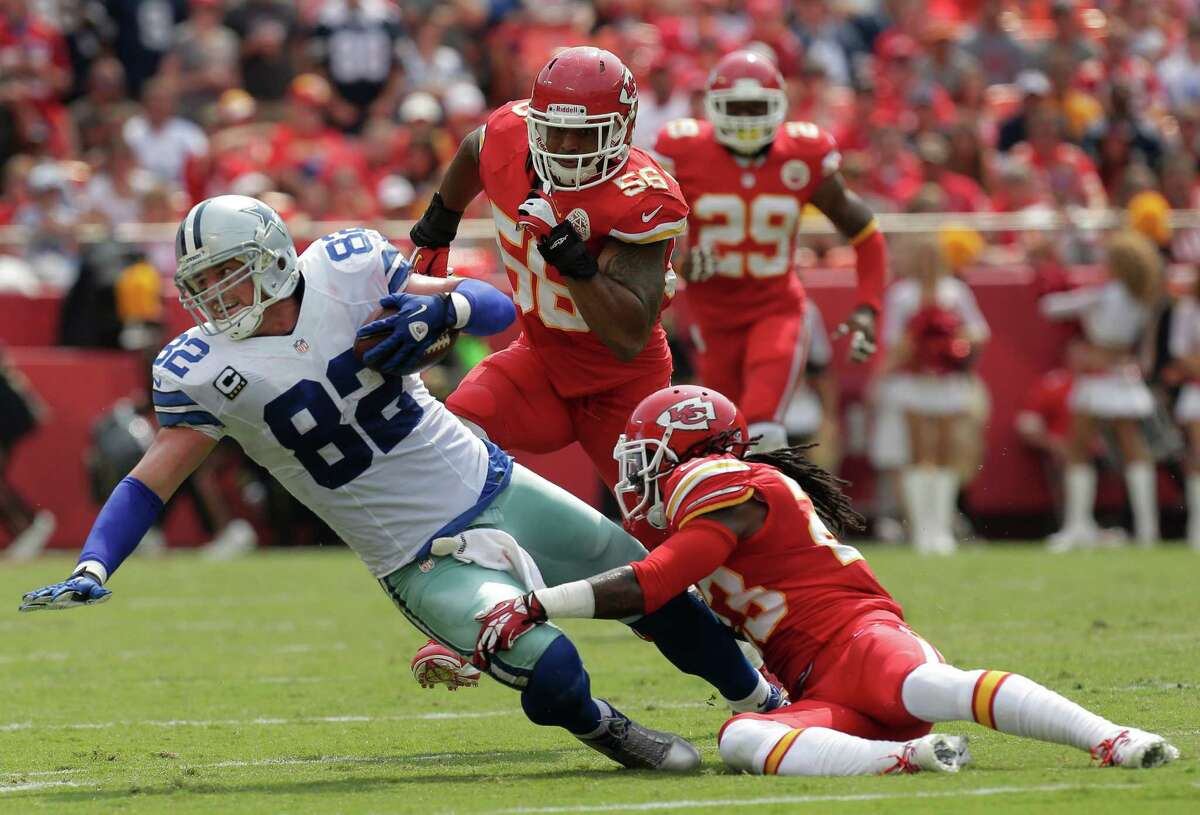 Dallas Cowboys tight end Jason Witten (82) is tackled after a catch by Kansas City Chiefs free safety Kendrick Lewis (23) during the first half of an NFL football game at Arrowhead Stadium in Kansas City, Mo., Sunday, Sept. 15, 2013. (AP Photo/Charlie Riedel)