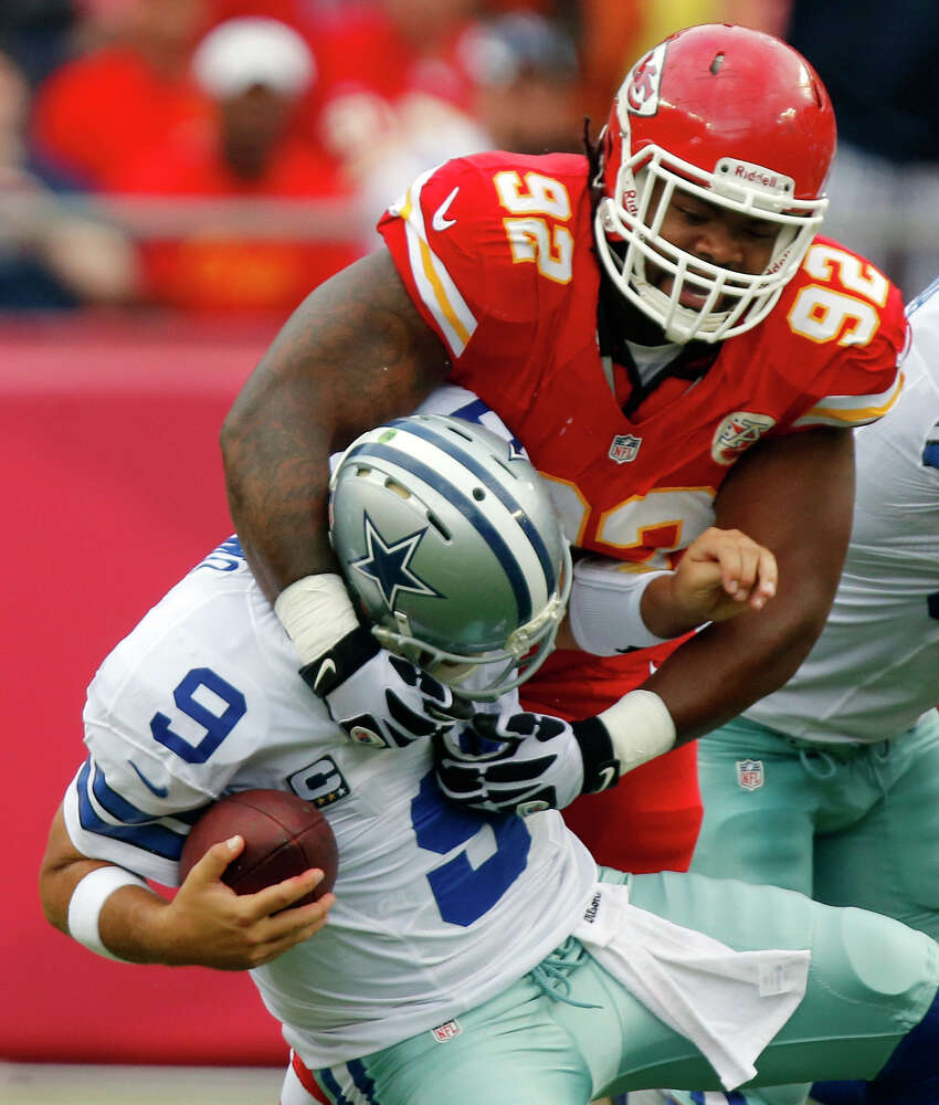 Dallas Cowboys quarterback Tony Romo (9) is sacked by Kansas City Chiefs nose tackle Dontari Poe (92) during the first half of an NFL football game at Arrowhead Stadium in Kansas City, Mo., Sunday, Sept. 15, 2013. (AP Photo/Ed Zurga)