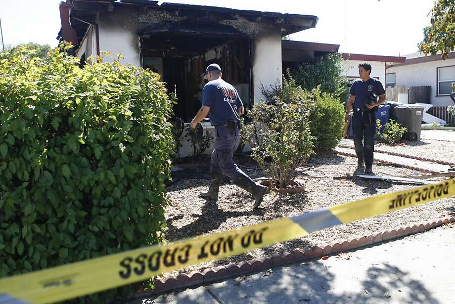 Contra Costa County fire investigators inspect the scene of the fire on DiMaggio Avenue that killed three women. Photo: Raphael Kluzniok, The Chronicle