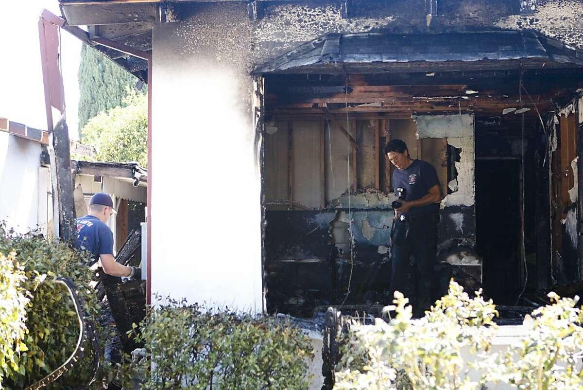 Contra Costa County Fire Investigators investigate the scene of a fatal fire in Pittsburg, Calif. on Sunday, Sept 15, 2013.