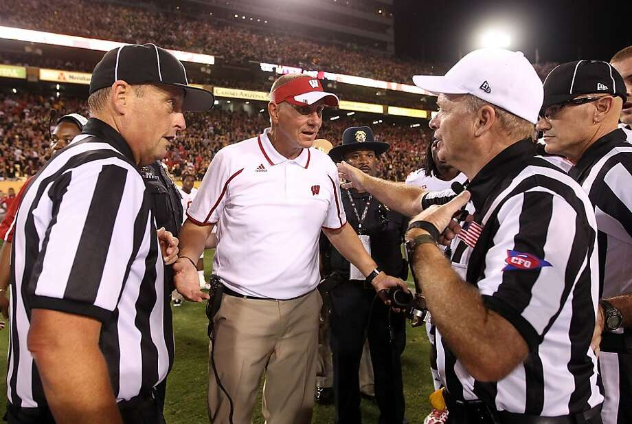"Wisconsin's Gary Andersen talks with officials at game's end, but later said: ""I got no answer."" Photo: Christian Petersen, Getty Images"