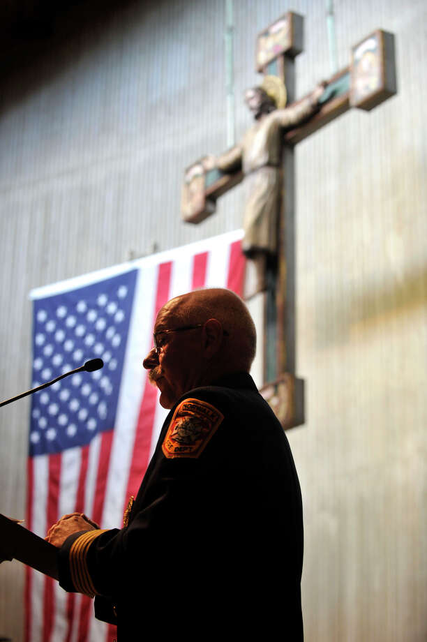 Norwalk Fire Chief Denis McCarthy gives the secod reading during Blue Mass honoring first responders at St. Philip Church in Norwalk, Conn., on Sunday, Sept. 15, 2013. Photo: Jason Rearick / Stamford Advocate