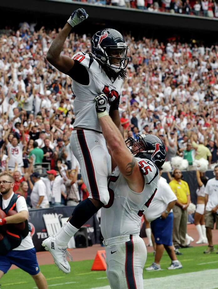 Houston Texans' DeAndre Hopkins (10) is lifted by teammate Chris Myers after scoring the winning touchdown against the Tennessee Titans during overtime of an NFL football game on Sunday, Sept. 15, 2013, in Houston. (AP Photo/David J. Phillip) Photo: David J. Phillip, Associated Press / AP